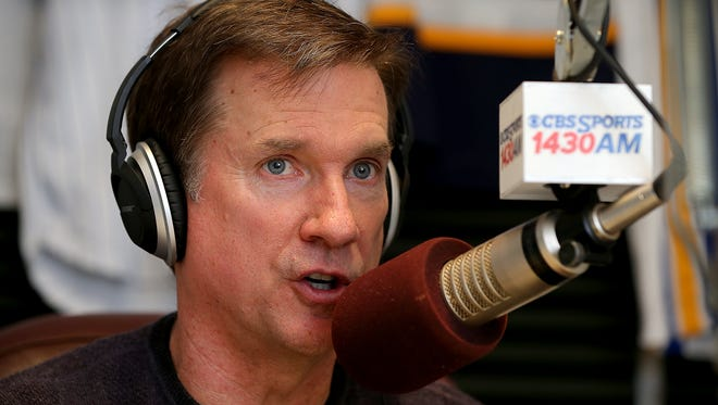 Kent Sterling, CBS Sports radio 1430am, talks with his producer at the top of his sports talk radio show Monday, February 16, 2015, afternoon at their North Meridian Street studio.