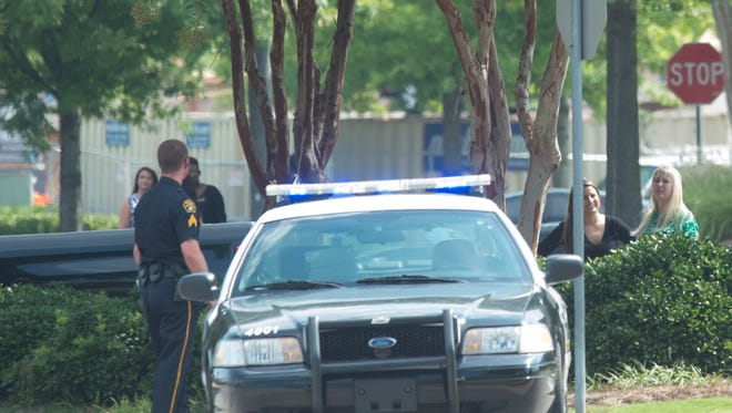 Montgomery Police, Alabama Law Enforcement Agency, and Montgomery Fire Department respond to a bomb threat at the East Chase Mall in Montgomery, Ala., on Monday, July 20, 2015. MPD blocked off all the entrances and evacuated the mall.