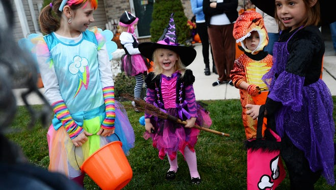 From left, Riley Siler, Nevaeh Murphy, Dakota Horner and Lillian Rankin gather during trick-or-treat night in Dillsburg in 2014.