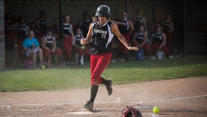 Wapahani's Regan Rose runs home against Richmond at Wapahani High School Tuesday, April 19, 2016.