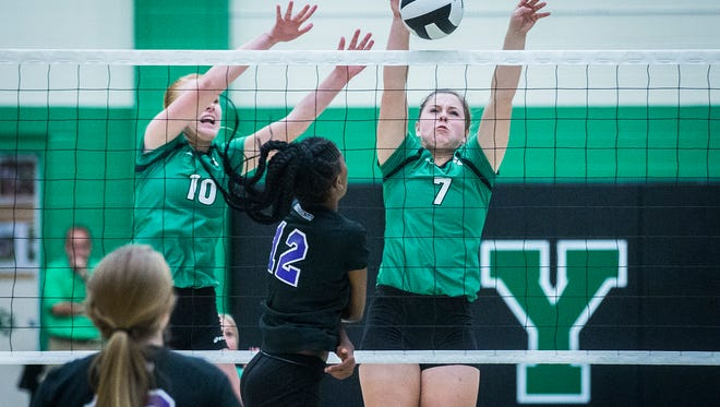 Yorktown's Olivia Reed blocks a hit from Central during their game at Yorktown High School Thursday, Aug. 18, 2016.