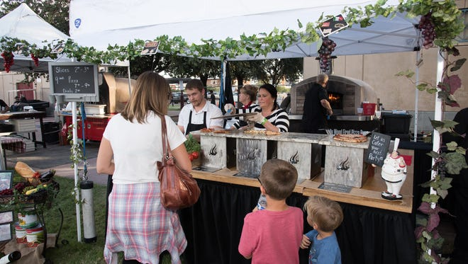 The 2016 Phoenix Pizza Festival held this years event at Margaret T. Hance Park in Downtown Phoenix on Saturday, Nov. 19, for a sold out afternoon of pizza, beer, wine and games. Over a dozen pizza makers were on hand slinging various types of pizza by the slice or whole pie.