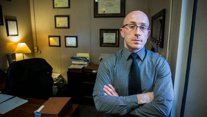Chief Deputy Prosecutor Zach Craig in his office at the Delaware County Building.