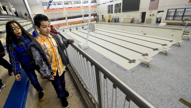 David Warde, left, and Joel Roman, 4th graders with McKinley Elementary School, look over the current condition of the William Penn swimming pool following a press conference on Thursday, Jan. 26, 2017.