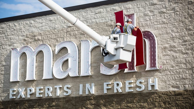 Workers with SignDoc removed the sign from the former site of the Marsh at McGalliard and Wheeling on Aug. 4. Kroger plans to put Pay Less brand grocery stores there and at the site of the former Marsh on Tillotson Avenue.