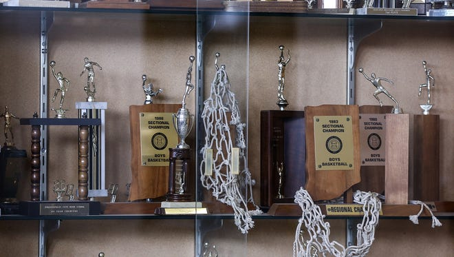 IPS sports are lagging, and the district athletic director hopes to turn the tide. One big change: Broad Ripple will close at the end of this school year. A case in the lobby of the school displays the trophies earned by the school's teams.