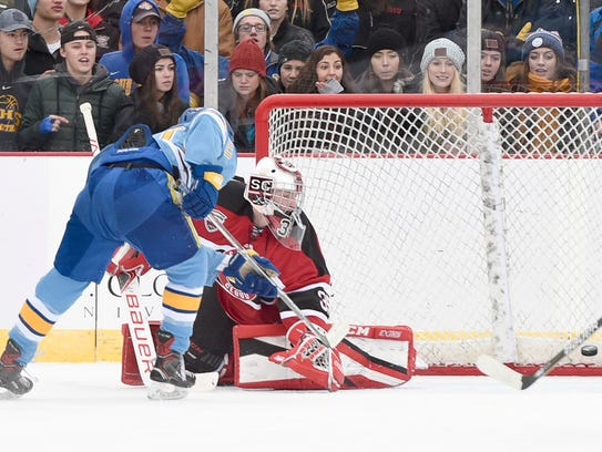 St. Cloud Cathedral's Jack Smith scores on St. Cloud