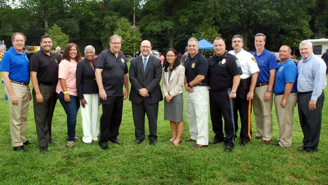 From left to right, Union County Freeholder Chairman Bruce Bergen, Union County Freeholder Vice Chairman Sergio Granados, Union County Freeholder Linda Carter, Union County Freeholder Vernell Wright, Union County Sheriff Joseph Cryan, New Jersey Attorney General Christopher S. Porrino, acting Union County Prosecutor Grace H. Park, acting Union County Prosecutor's Office Chief of Detectives John McCabe, Jr., Springfield Police Chief John Cook, Mountainside Police Chief Alan Attanasio, Union County Public Safety Director Andrew Moran, Union County Police Department Officer-in-Charge Christopher Debbie, and Union County Manager Alfred Faella appear at the Union County Board of Chosen Freeholders' National Night Out event at Meisel Park in Springfield on Tuesday, August 2.