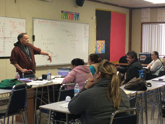 A class at the Coachella Valley Adult School learns math during their Spanish-language GED course.