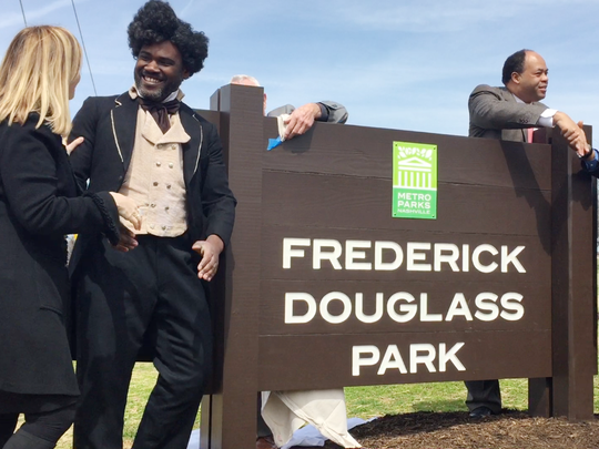 Mayor Megan Barry, left, shakes the hand of Frederick