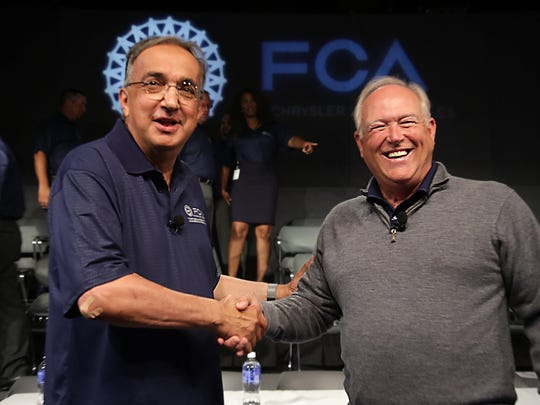 Fiat Chrysler CEO Sergio Marchionne, left, shakes hands with UAW President Dennis Williams, during an event to mark the ceremonial beginning of its contract talks  at the UAW-Chrysler National Training Center in Detroit on Tuesday, July 14, 2015.