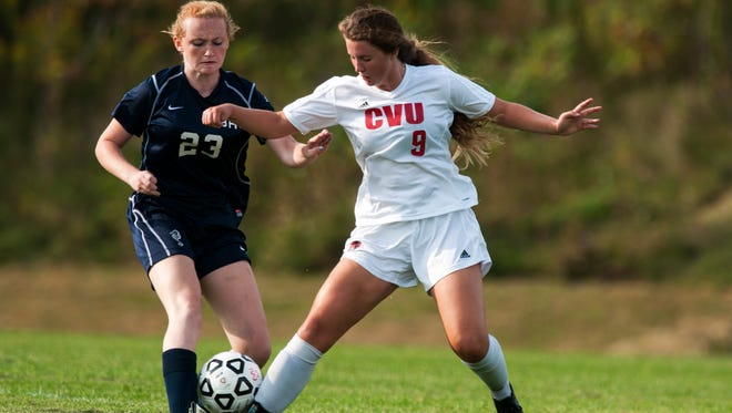 CVU's Catherine Cazayoux (9) battles for the ball with Burlington's Hannah Kate (23) during the girls varsity soccer game on Tuesday in Hinesburg.