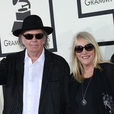 1/26/14 3:14:27 PM -- Los Angeles, CA, U.S.A  --  From left, Neil Young and Pegi Young arrive at the 56th Annual Grammy Awards at the Staples Center in Los Angeles, CA --    Photo by Dan MacMedan, USA TODAY contract photographer  ORG XMIT:  DM 130582 2014 GRAMMY AWAR 1/24/2014 (Via OlyDrop)