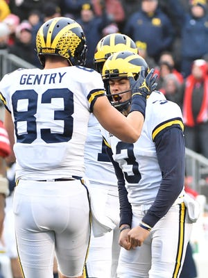 Michigan's Quinn Nordin celebrates a field goal in the third quarter during Saturday's loss at Wisconsin.
