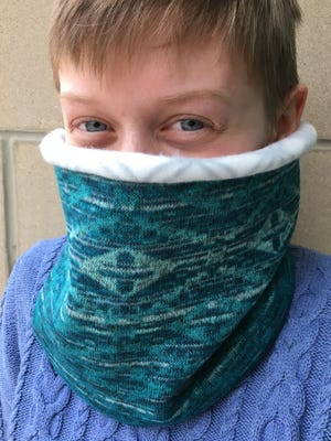"""Learn to make an easy reversible neck warmer while being trained on the either the sewing machine or the serger at classes in the Fond du Lac Public Library's Idea Studio Dec. 6 and 7. For more information, visit fdlpl.org, click """"Calendar."""""""