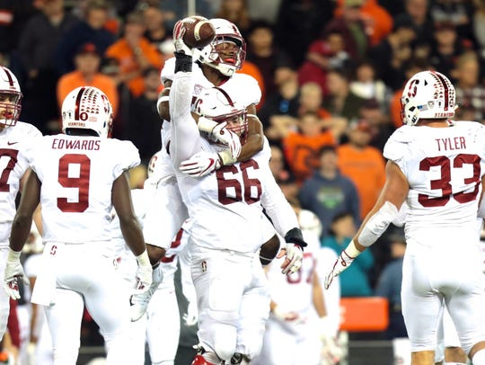 Stanford defensive lineman Harrison Phillips (66) celebrates