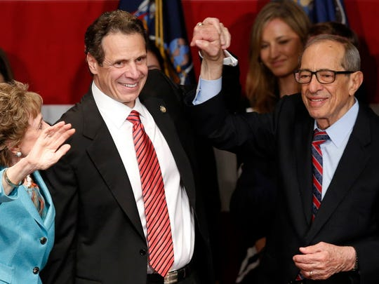Democratic New York Gov. Andrew Cuomo, second from left, celebrates with his father, former New York Gov. Mario Cuomo, right, and his mother, Matilda, left, after defeating Republican challenger Rob Astorino, at Democratic election headquarters in New York on Nov. 4, 2014.