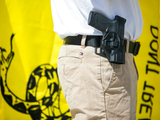 People participate in a gun-rights rally in Harrisburg,