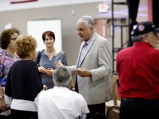 In this May 8, 2018, file photo, Clark County Commission member Steve Sisolak meets with people during a forum for Nevada gubernatorial candidates organized by Nevada faith groups. The fiercest primary election battle in Nevada this year is a race between two Democrats vying to become the swing state's first Democratic governor in almost two decades. The fight between Sisolak and Christina Giunchigliani has seen them spar over their response to the October mass shooting in Las Vegas while pledging to resist President Donald Trump and the National Rifle Association.