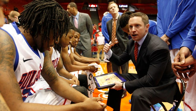 Louisiana Tech Bulldogs head coach Michael White speaks to his team before facing the Tulsa Golden Hurricane in the championship game of the Conference USA college basketball tournament at Don Haskins Center.