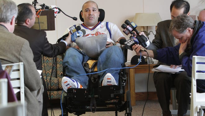 Samuel Rivera, a Metro-North employee who was paralyzed in December's derailment, talks about his injuries and his family during a news conference at Burke Rehabilitation Center April 9, 2014. His attorney announced a $100 million lawsuit against Metro-North.