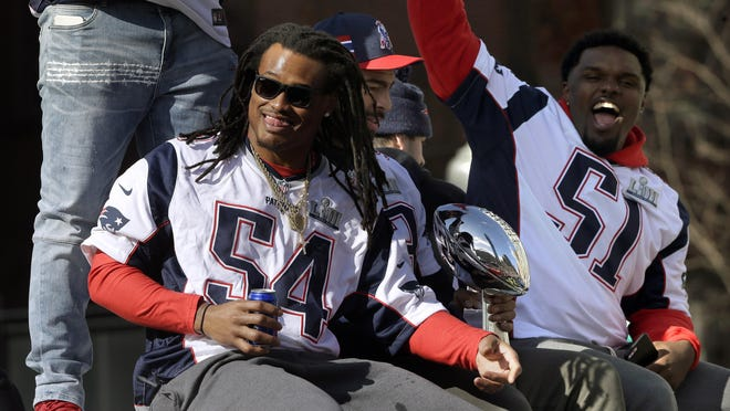 Patriots linebackers Dont'a Hightower, left, and Ja'Whaun Bentley parade through downtown Boston on Feb. 5, 2019, to celebrate their win over the Los Angeles Rams two days earlier in Super Bowl LIII in Atlanta.