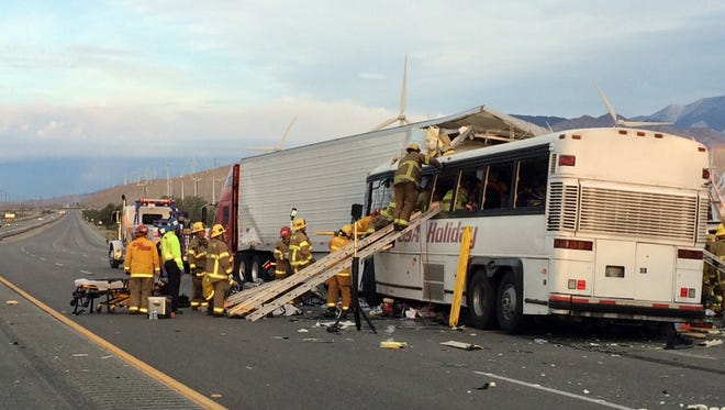 Emergency personnel work to remove victims from a tour bus crash on Interstate 10 on Sunday, Oct. 23, 2016. Thirteen people, including the bus driver, were killed.