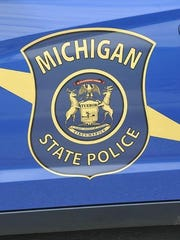 Michigan State Police Trooper Adam Mullin, 25, of the Caro post was arraigned Friday on charges of assault with intent to do great bodily harm, obstruction of justice, official misconduct, assaulting a police officer causing injury, aggravated domestic violence and committing a felony while carrying a firearm.