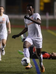 Central York's Igor Gomes takes the ball up the field
