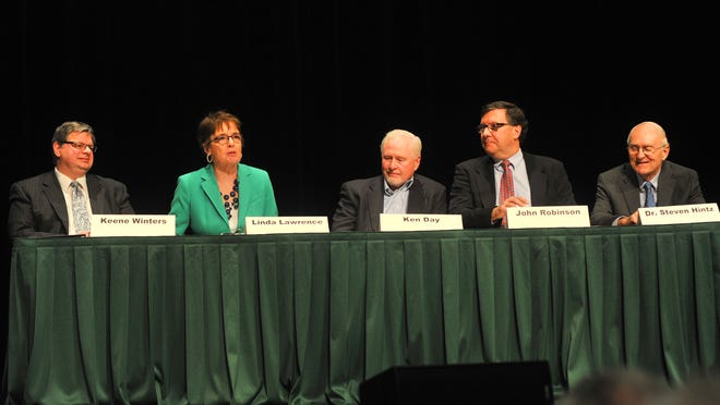 Panelists Keene Winters, left, Linda Lawrence, Ken Day, John Robinson, and Steven Hintz, debate on city leadership Tuesday, March 17, 2015, at UW Center for Civic Engagement in Wausau.