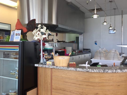 A gleaming hood spans the open kitchen at Carmelita's Taqueria.