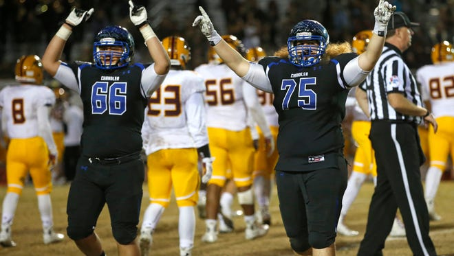 Chandler players celebrate after defeating Phoenix Mountain Pointe in the Division I semifinals Nov. 21, 2014 at Hamilton High in Chandler.
