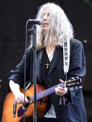 Patti Smith, who grew up in Pitman, is pictured performing