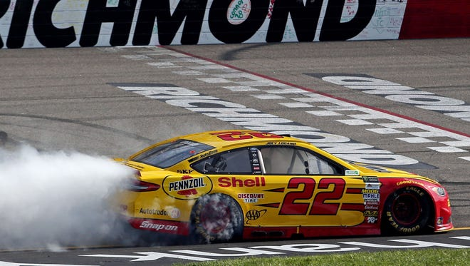 Joey Logano leaves a smoke trail as he celebrates his first win of the season.