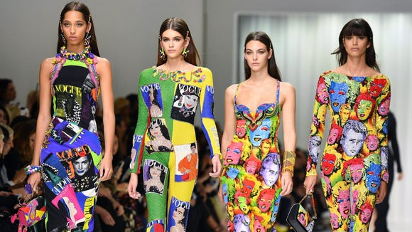 Kaia Gerber (second from the left) and her runway girl