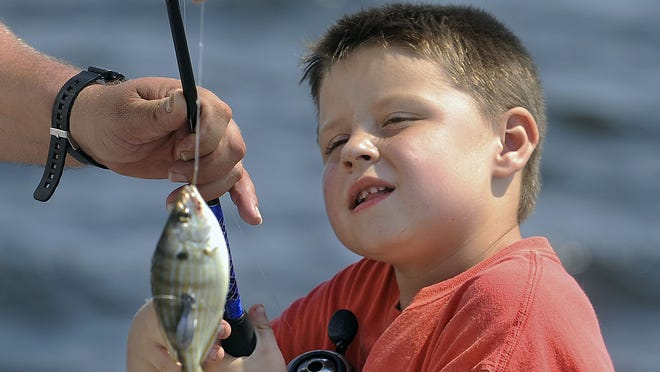 The 39th annual Fishing Rodeo is at 4 p.m. Friday, 5 a.m. Saturday through 5 p.m. Sunday, May 16 through 18, at Shoreline Park in Gulf Breeze.   John Blackie/jblackie@pnj.com Joseph Douglas, 5, checks out his catch Saturday during the fishing event at Shoreline Park. Joseph Douglas,5, checks out his catch Saturday during the Pensacola Recreational Fisherman's Association's  Kids Fishing Clinic/Family Fishing Rodeo at Shoreline Park.
