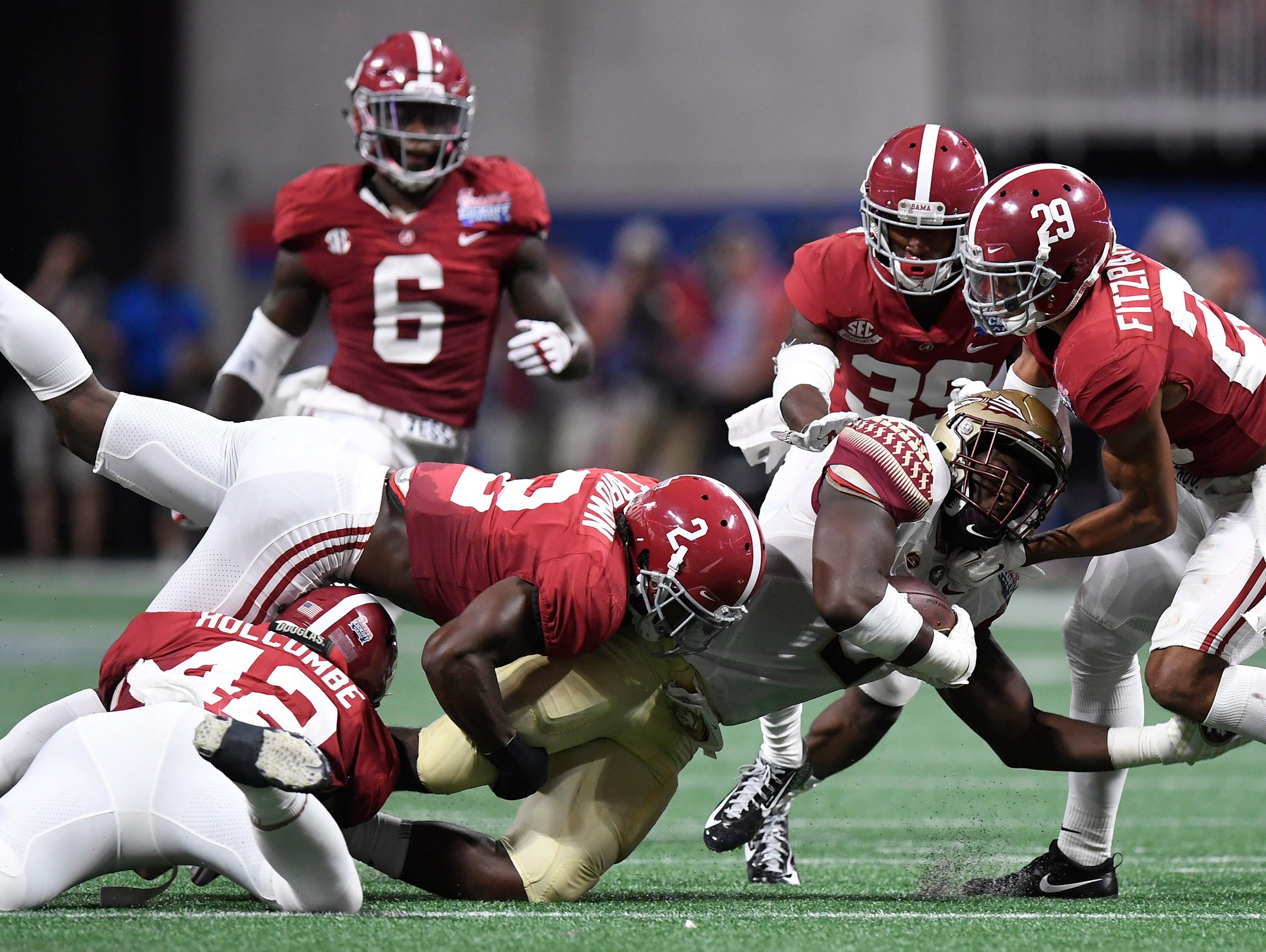 Florida State running back Jacques Patrick (9) is stopped by Alabama defensive back Tony Brown (2), defensive back Minkah Fitzpatrick (29) and defensive back Levi Wallace (39) in the Chick-fil-a Classic at the Mercedes - Benz Stadium in Atlanta, Ga., on Saturday September 2, 2017. (Mickey Welsh / Montgomery Advertiser)