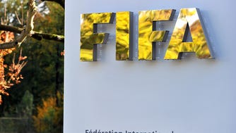 FILE - According to reports, the U.S. Justice Department plans to announce corruption charges against officials at FIFA, the world's governing body of football. ZURICH, SWITZERLAND - OCTOBER 20:  The FIFA logo is seen outside the FIFA headquarters prior to the FIFA Executive Committee Meeting on October 20, 2011 in Zurich, Switzerland. During their third meeting of the year, held over two days, the FIFA Executive Committee will approve the match schedules for the FIFA Confederations Cup Brazil 2013 and the 2014 FIFA World Cup Brazil.