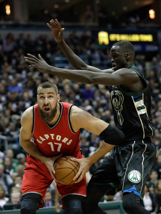Toronto Raptors' Jonas Valanciunas tries to shoot past Milwaukee Bucks' Thon Maker during the first half of game 3 of their NBA first-round playoff series basketball game Thursday, April 20, 2017, in Milwaukee. (AP Photo/Morry Gash)