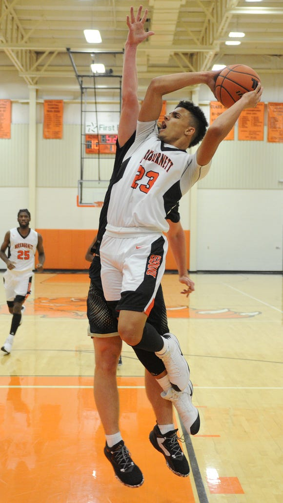 Burkburnett's Darion Chafin attempts a shot and is