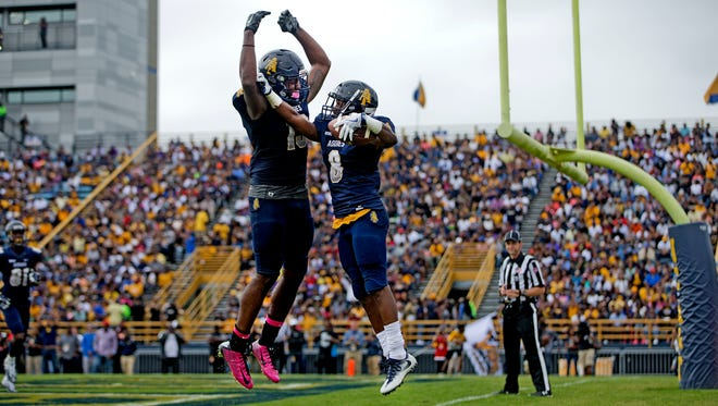 N.C. A&T's Elijah Bell and Khris Gardin celebrate a touchdown against Delaware State during N.C. A&T's homecoming last week.