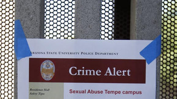 ASU posts signs at the Adelphi II Commons near Apache Boulevard and Rural in Tempe after an sexual assault occurred on Tuesday night, September 9, 2014.
