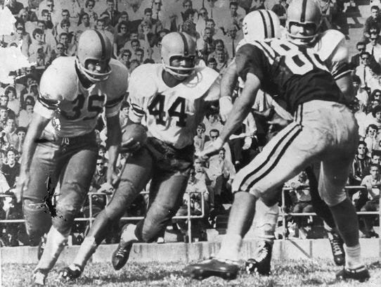 Ernie Davis became the first African-American to win