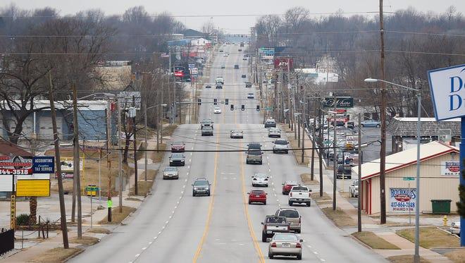 Cars and trucks travel along Kearney Street in Springfield on Feb. 8, 2017.
