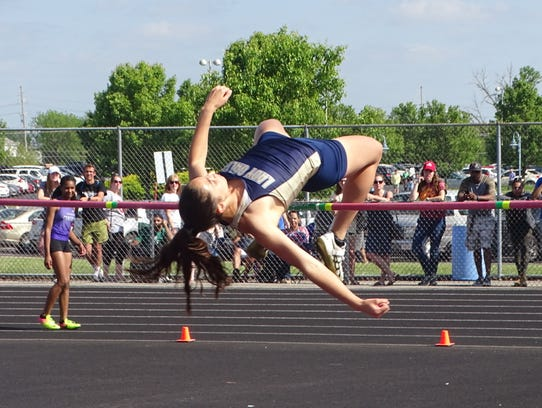 Lancaster senior Hope Purcell clears the bar at 5-feet-3