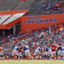 Apr 12, 2014; Gainesville, FL, USA; A general view of game play as Florida Gators quarterback Jeff Driskel (6) hands the ball off to running back Adam Lane (22) during the second half of the spring game at Ben Hill Griffin Stadium. Mandatory Credit: Rob Foldy-USA TODAY Sports