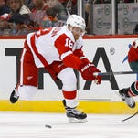 Detroit Red Wings center Joakim Andersson, left, plays against the Minnesota Wild on Dec. 28, 2015.
