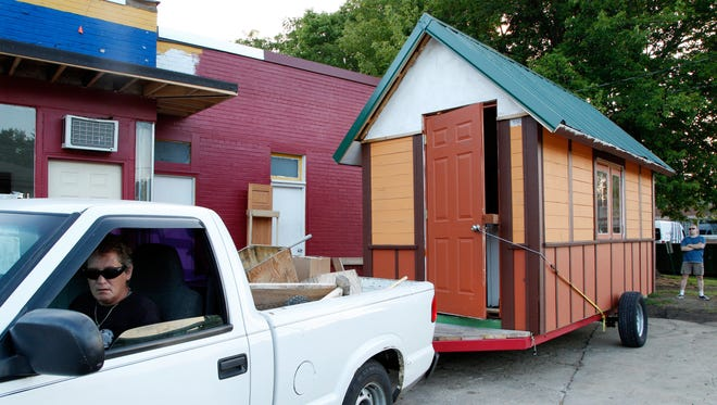 A tiny house in Madison, Wis.,is moved to a neighborhood of tiny houses.