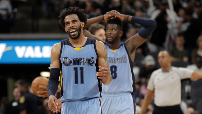 Memphis Grizzlies guard Mike Conley (11) and forward James Ennis III (8) react to a call during the second half in Game 2 against the San Antonio Spurs, Monday, April 17, 2017, in San Antonio.