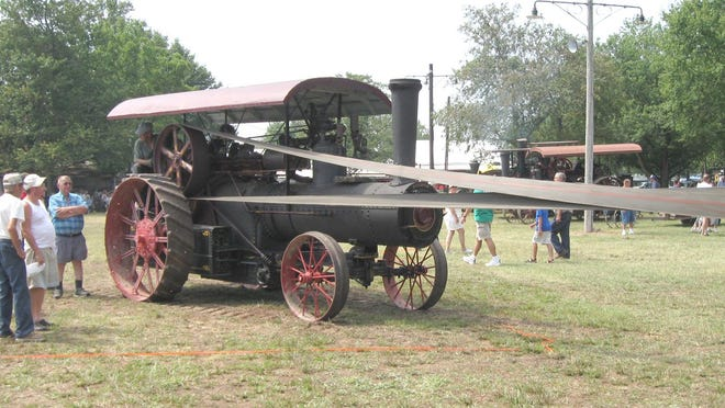 The Stant Family's 1927 8-1/2-by-10 Frick engine No. 30519 is the last traction engine built by the Frick Company of Waynesboro, Pennsylvania. It is shown belted to the thresher.